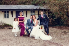 Bridal party - including flower girl in front of Barnabrow House