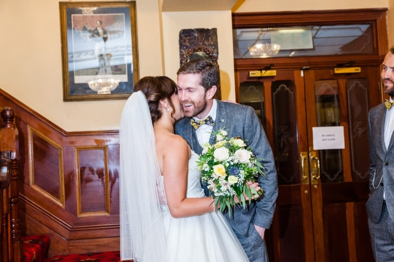 Bride greets her groom in the lobby of Emmet Hotel Clonakilty
