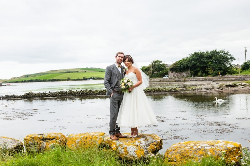 Bride and groom in front of the sea in Ring, Clonakilty