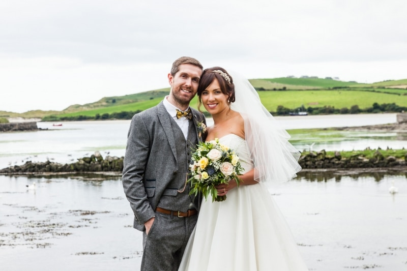 Close-up of Bride and groom in front of the sea in Ring, Clonakilty