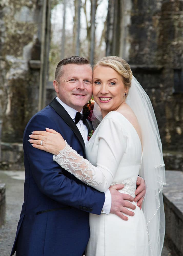 Bride and Groom pose at Muckross Abbey Wedding photos