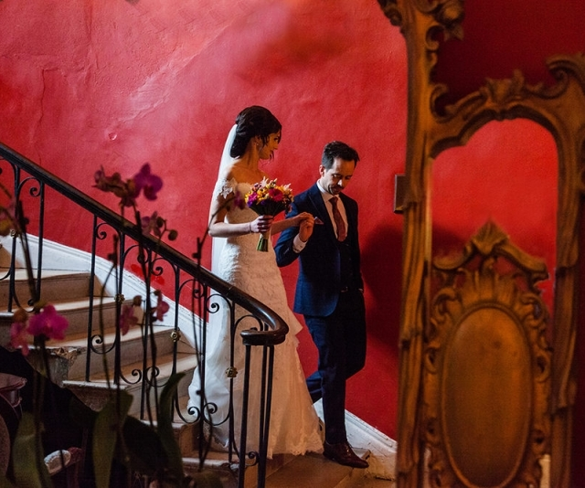 Bride and groom walk down the stairs at Maryborough House Cork